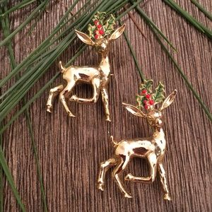 2 Vintage Reindeer Pins with Holly Made by Gerry's